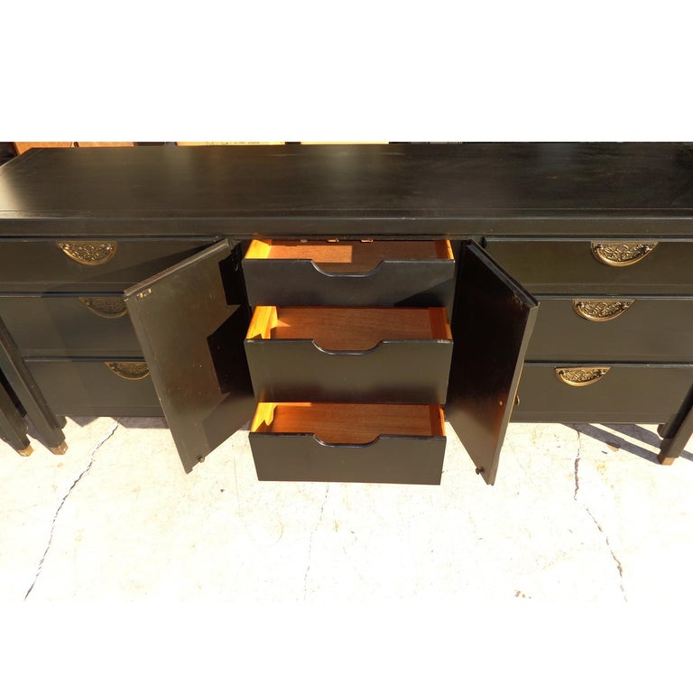 Century Chin Hua dresser credenza   Sideboard buffet or dresser manufactured by Century Furniture as part of the Chin Hua collection from the 1970s. Ebonized with beautiful brass pulls. The dresser features three drawers behind 2 cabinet doors and