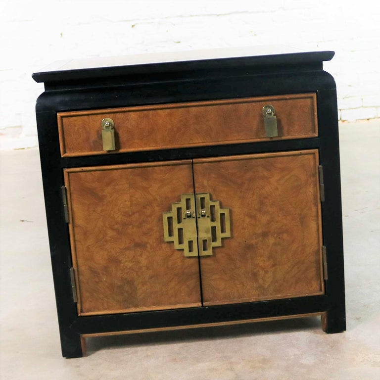 Handsome Hollywood Regency chinoiserie nightstand or end table cabinet designed by Raymond K. Sobota for his Chin Hua collection for Century Furniture. It is in wonderful vintage condition overall. It does have normal signs of age and use but