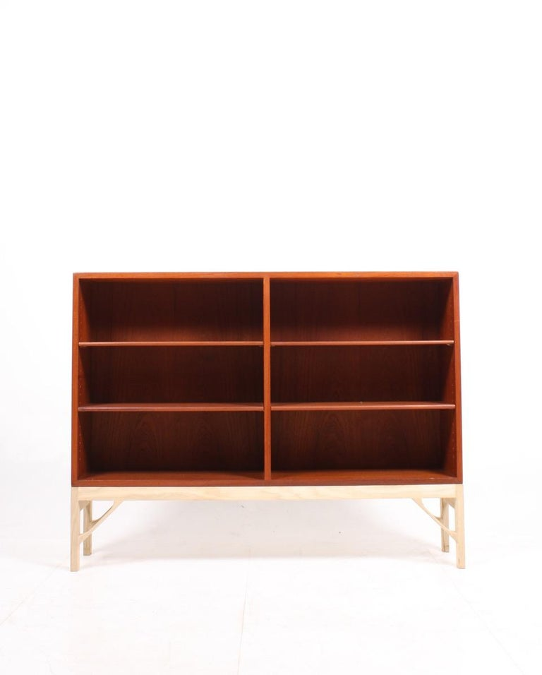 Low China bookcase in oiled teak on a soap finished oak base. Designed by MAA. Børge Mogensen in 1958, this piece is made by CM Madsen cabinetmakers Denmark in the 1960s. Great original condition.