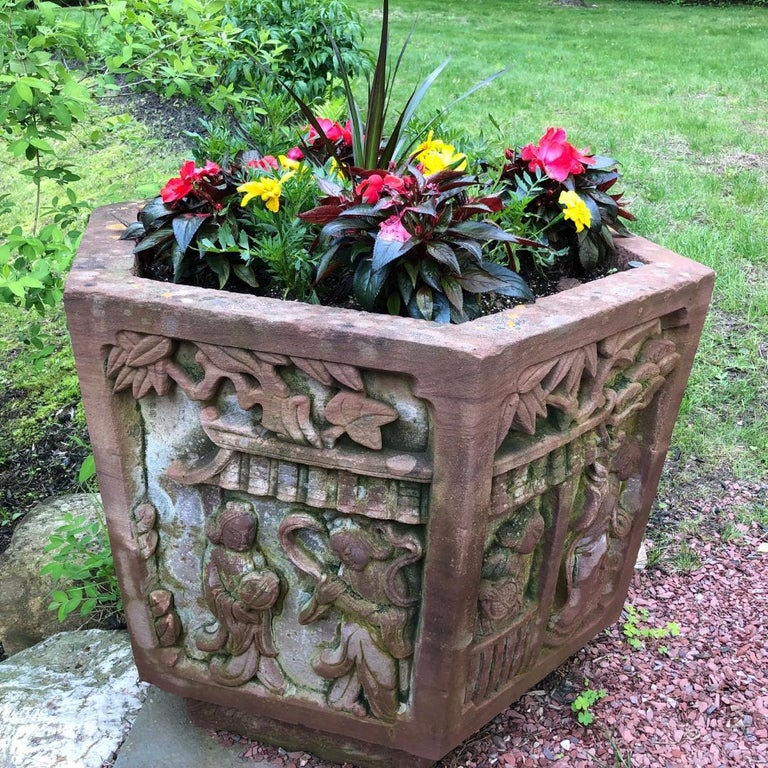 A lovely example for your special garden space  China hand carved antique hexagonal shaped red sand stone planter/ basin with deeply carved village scene side panels.  Dimensions:  23 inches high and  31 inches diameter and 2.5 inches thick, red