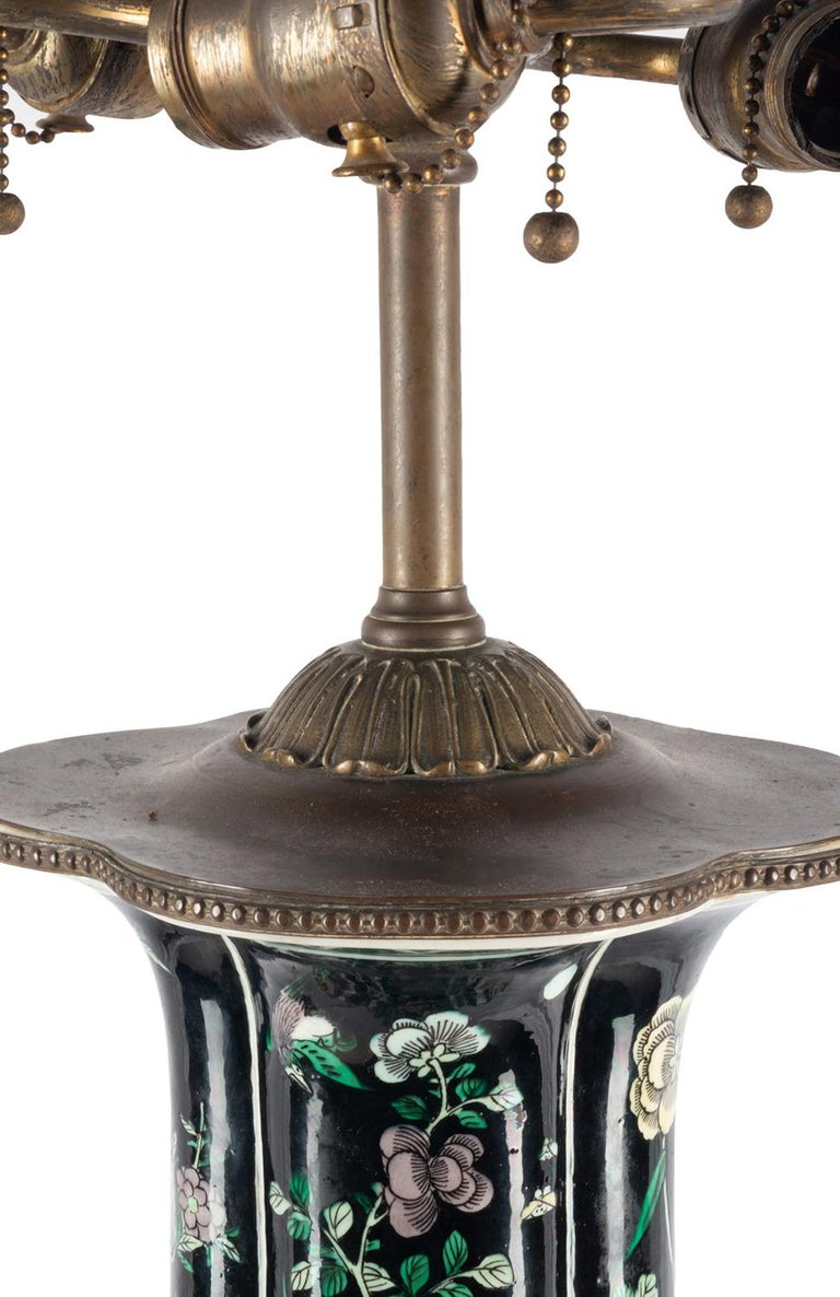 A very good quality 19th century Chinese famille noire vase / lamp. Having wonderful prunus blossom and chrysanthemums with birds among them, raised on a pierced ormolu base.