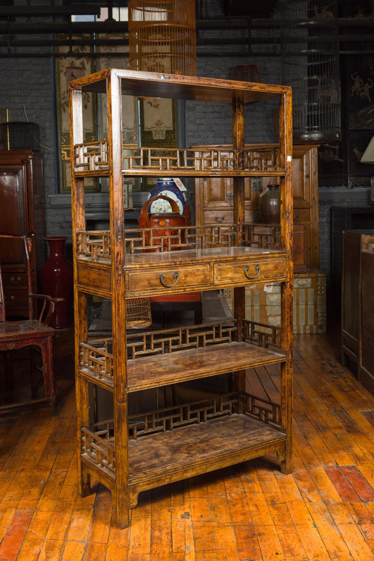 Chinese 19th Century Qing Dynasty Elm Bookcase with Fretwork Sides and Drawers In Good Condition For Sale In Yonkers, NY