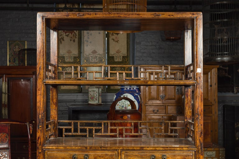 Chinese 19th Century Qing Dynasty Elm Bookcase with Fretwork Sides and Drawers For Sale 1