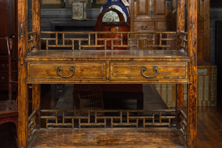 Chinese 19th Century Qing Dynasty Elm Bookcase with Fretwork Sides and Drawers For Sale 2