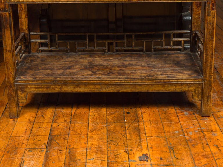 Chinese 19th Century Qing Dynasty Elm Bookcase with Fretwork Sides and Drawers For Sale 4