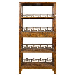 Chinese 19th Century Qing Dynasty Elm Bookcase with Fretwork Sides and Drawers