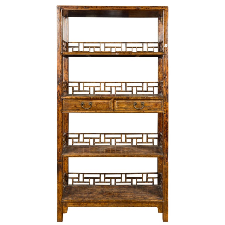 Chinese 19th Century Qing Dynasty Elm Bookcase with Fretwork Sides and Drawers For Sale