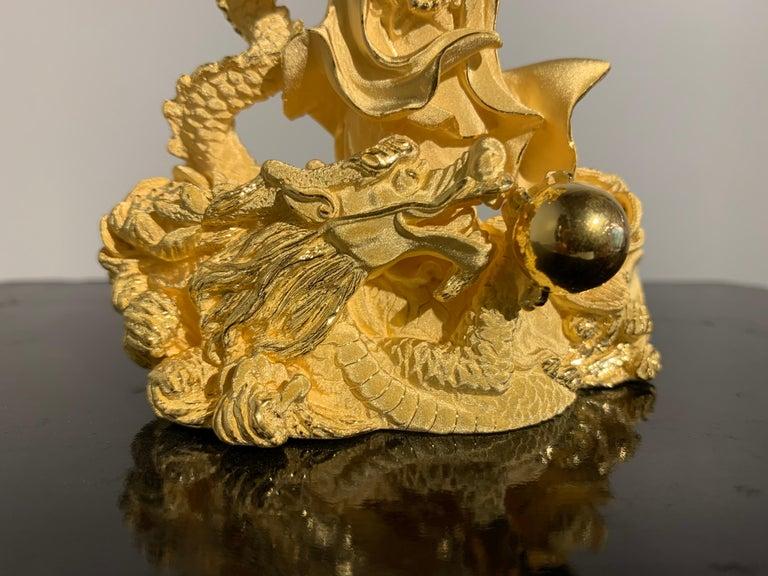 24 karat gold dragon jade ball statue
