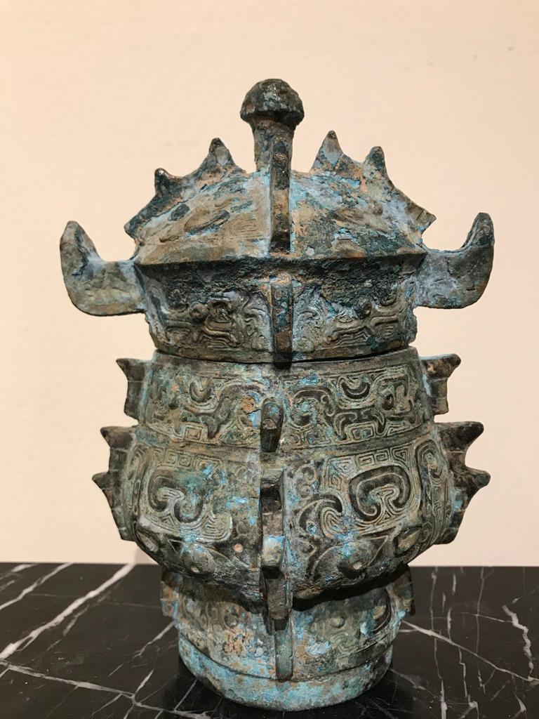 Late Shang Dynasty style bronze ritual lidded vessel with incised archaistic designs covering the surface and a wonderful variegated Verdigris patina. A very interesting decorative bronze piece.