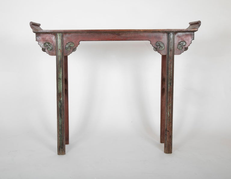 A tall Chinese altar table with original lacquer finish.