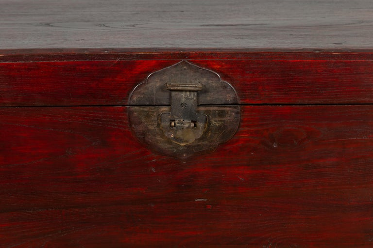 20th Century Chinese Antique Red Lacquered Trunk with Incised and Carved Motifs and Handles For Sale