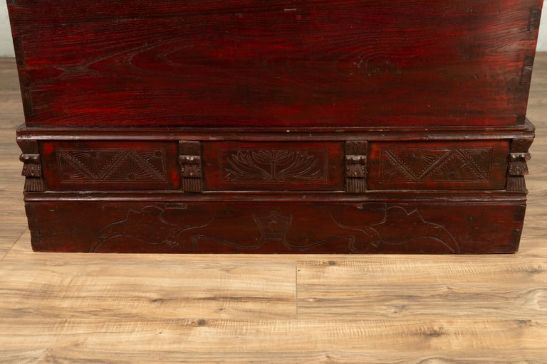 Wood Chinese Antique Red Lacquered Trunk with Incised and Carved Motifs and Handles For Sale