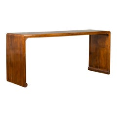 Chinese Antique Waterfall Console Table with Scrolling Feet and Warm Patina
