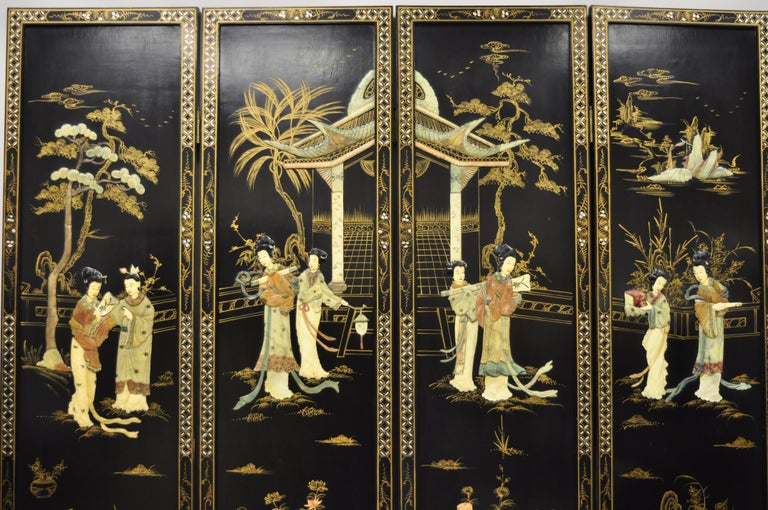 Vintage Chinese black lacquer carved soapstone geisha girl 4 panel folding screen room divider. Item features (4) folding panels, carved soapstone geisha girl scenes, gold paint decorated rear, very nice vintage item, great style and form. Circa Mid