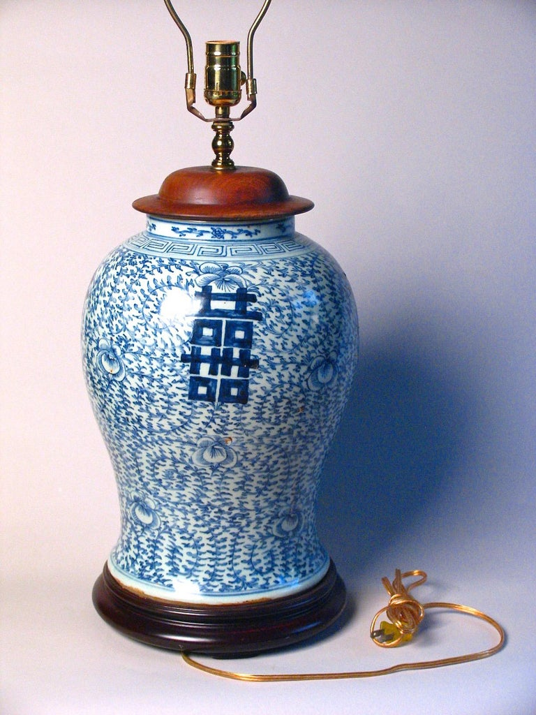 Chinese blue and white baluster vase fitted as a lamp. Ceramic vase with a cobalt blue underglaze design of convolvulus bindweed, a symbol of love and marriage, with four bold hei (double happiness) characters, with key-fret pattern at the