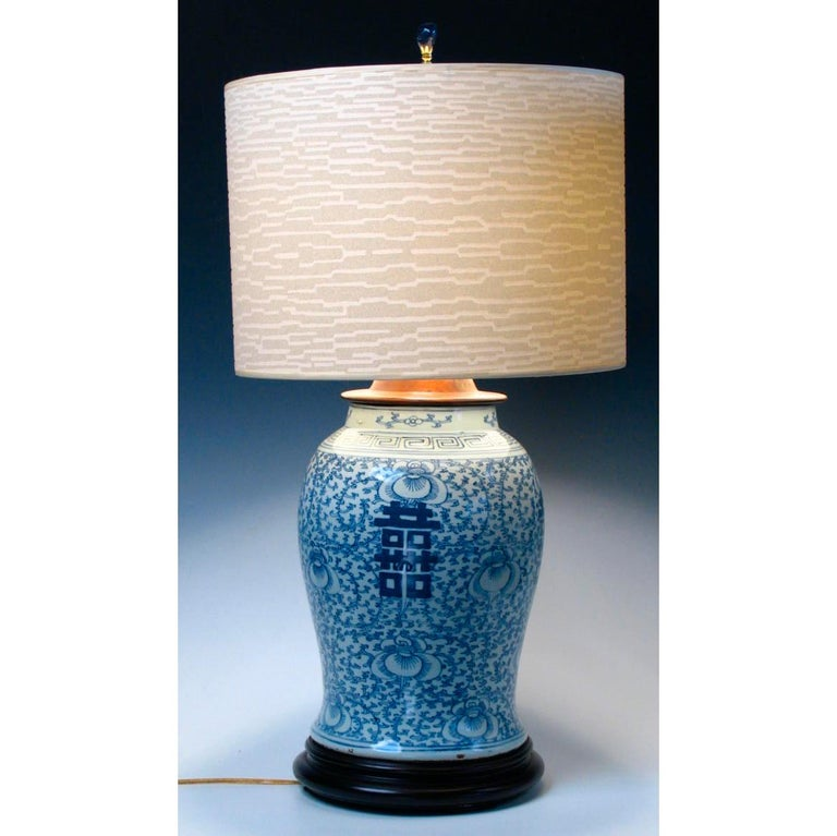 Chinese blue & white baluster vase fitted as a lamp. Ceramic vase with a cobalt blue under-glaze design of convolvulus bindweed, a symbol of love and marriage, with four bold hei (double happiness) characters, with key-fret pattern at the