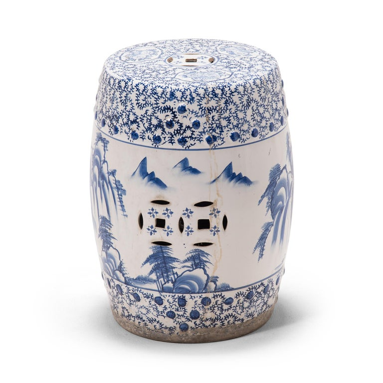 This beautiful ceramic garden stool is shaped in the traditional drum form and covered with intricate blue-and-white designs. The drum is adorned with a mountainous landscape scene, painted in the expressive style of traditional calligraphy