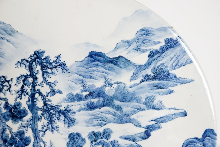 Chinese Export Chinese Blue and White Porcelain Plaque with a Carved Wooden Stand For Sale