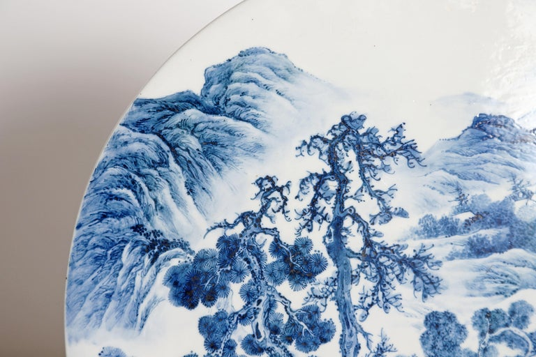 Hand-Carved Chinese Blue and White Porcelain Plaque with a Carved Wooden Stand For Sale