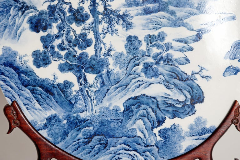 Chinese Blue and White Porcelain Plaque with a Carved Wooden Stand In Good Condition For Sale In Dallas, TX