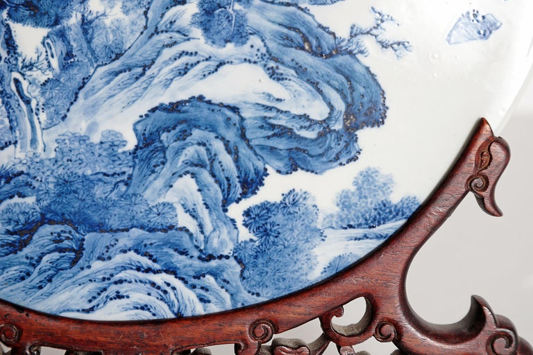 20th Century Chinese Blue and White Porcelain Plaque with a Carved Wooden Stand For Sale
