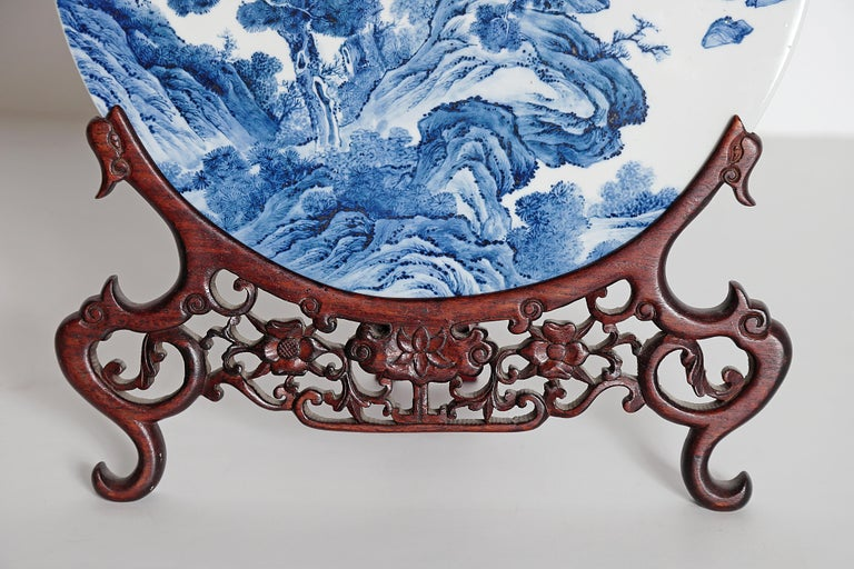 Chinese Blue and White Porcelain Plaque with a Carved Wooden Stand For Sale 1