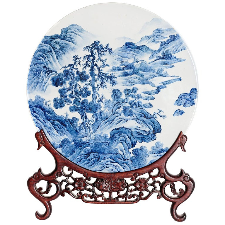 Chinese Blue and White Porcelain Plaque with a Carved Wooden Stand For Sale