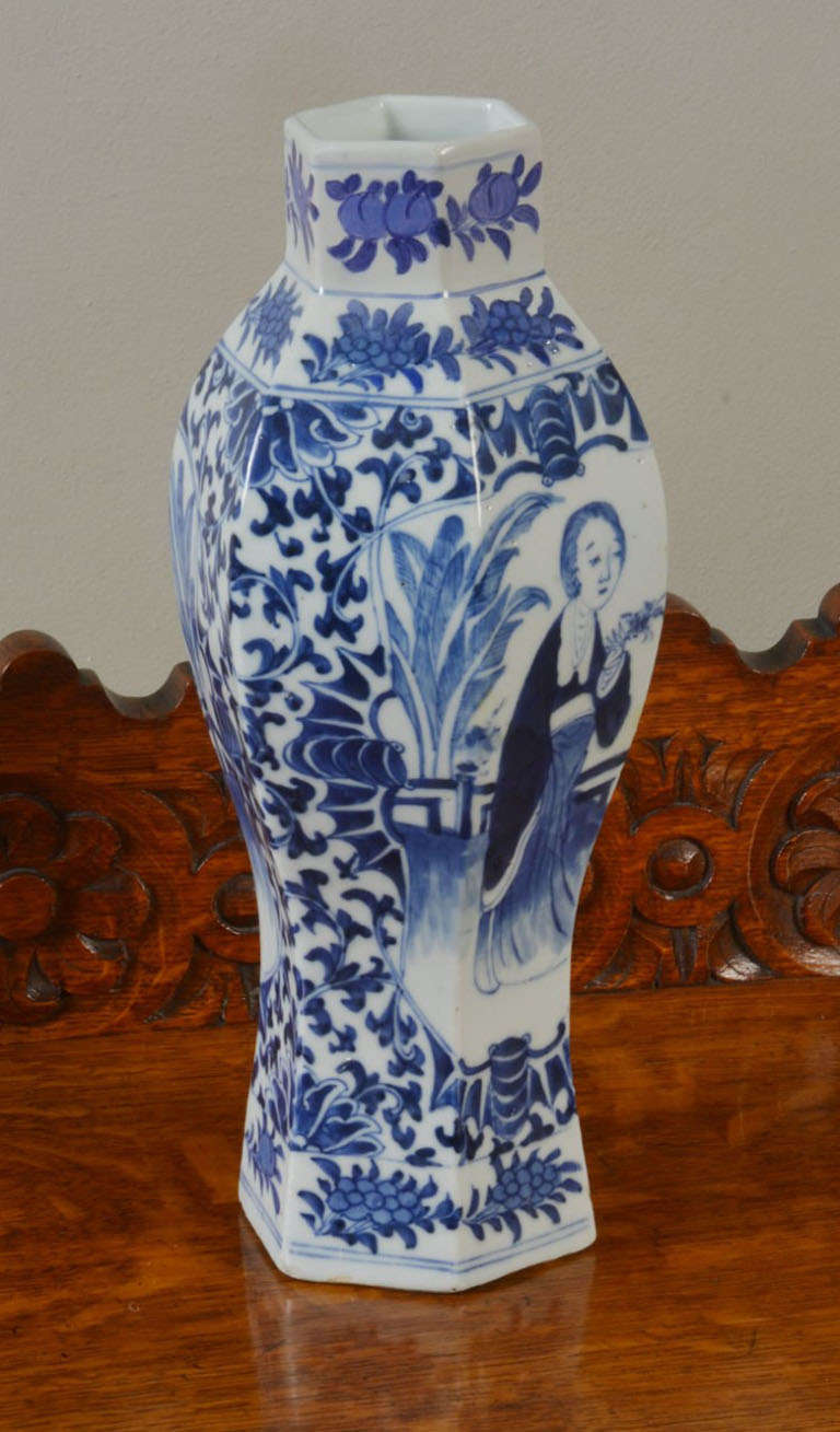 Chinese blue and white vase decorated with oriental figures and foliage having four character marks.