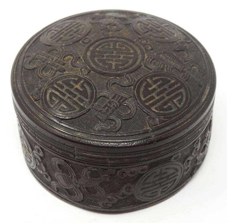 Offering this gorgeous hand carved Chinese box that is done from a coconut shell. The motif is the same all around with scrollwork, and Chippendale patterns. From the age of the piece there is a couple of cracks on the inside but they do not effect