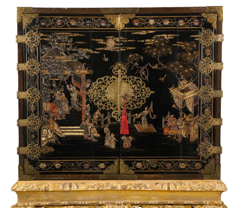 The cabinet doors decorated with court scenes with pierced foliate hinges & lock plates enclosing eleven drawers decorated with different scenes, all on a giltwood stand. Provenance: The 2nd viscount Camrose, Hackwood Park, Basingstoke,