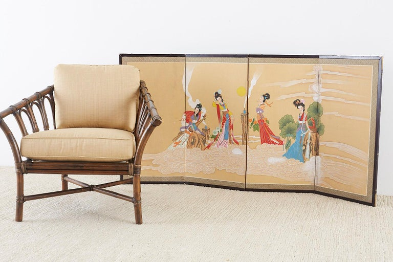 Whimsical Chinese four-panel byobu style screens depicting four celestial beauties in clouds. Colorful medium sized screen, ink and color painted on gold silk ground, 20th century titled and signed left side. Set in a wooden frame with a silk