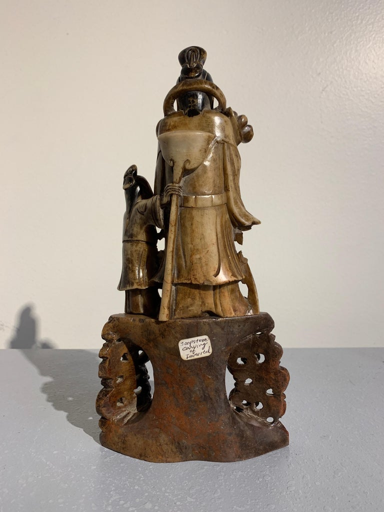 Hand-Carved Chinese Carved Soapstone Immortal and Attendant, Qing Dynasty, 19th Century For Sale