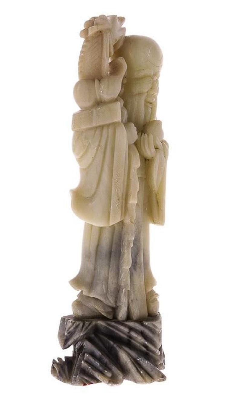 A finely carved stone sculpture of a wise old man with a dragon on his shoulder standing on a Braun stone base.