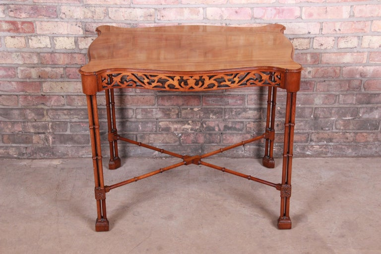 A gorgeous Chinese Chippendale carved mahogany faux bamboo tea table or occasional side table  By Beacon Hill  USA, mid-20th century  Measures: 32.25