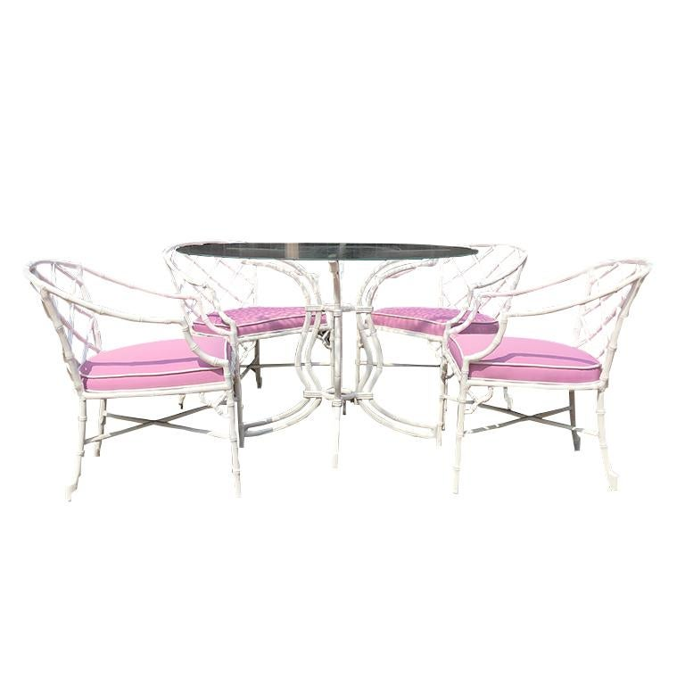 White chippendale faux bamboo iron patio set 4 arm chairs pink sunbrella fabric   Rare set of aluminium metal faux bamboo garden patio set or dining set. Made in the Chinese Chippendale taste. From the Hollywood Regency era featuring humpback frames
