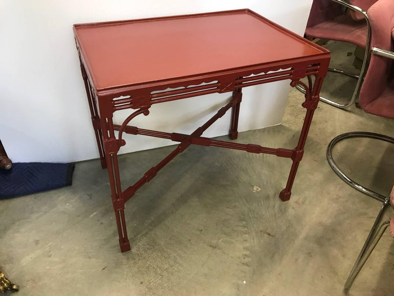 A traditional Chinese Chippendale English style tea table. This Classic styled table is lacquered in a cinnabar red and can be used in a traditional or more modern setting. The square top with slight gallery edge is supported by four legs made of