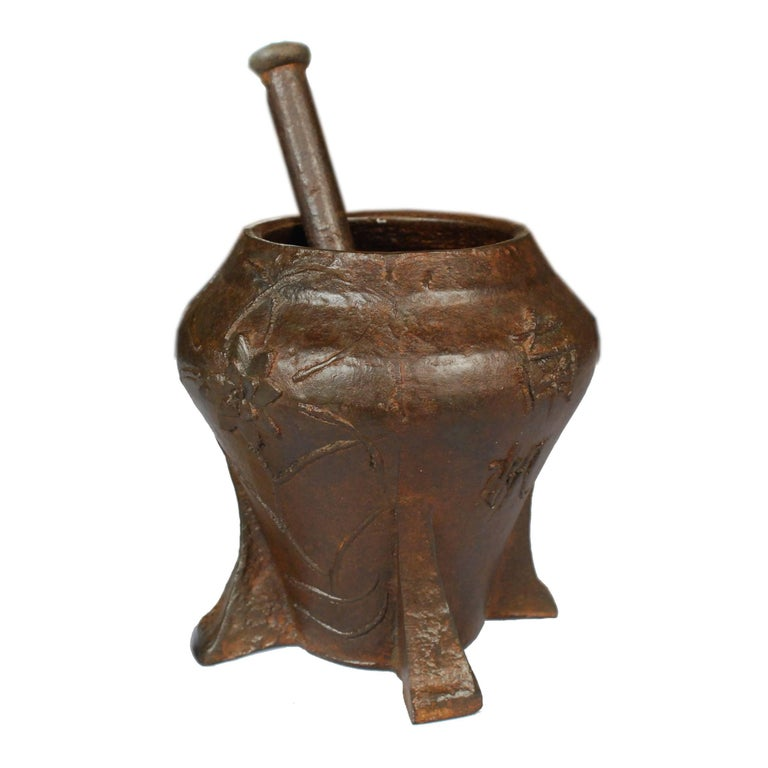 This vintage mortar and pestle from Shanxi, China was cast in iron with a floral relief. It was originally used in a traditional apothecary to create herbal medicine. The container happens to be just the right size to beautifully accommodate a