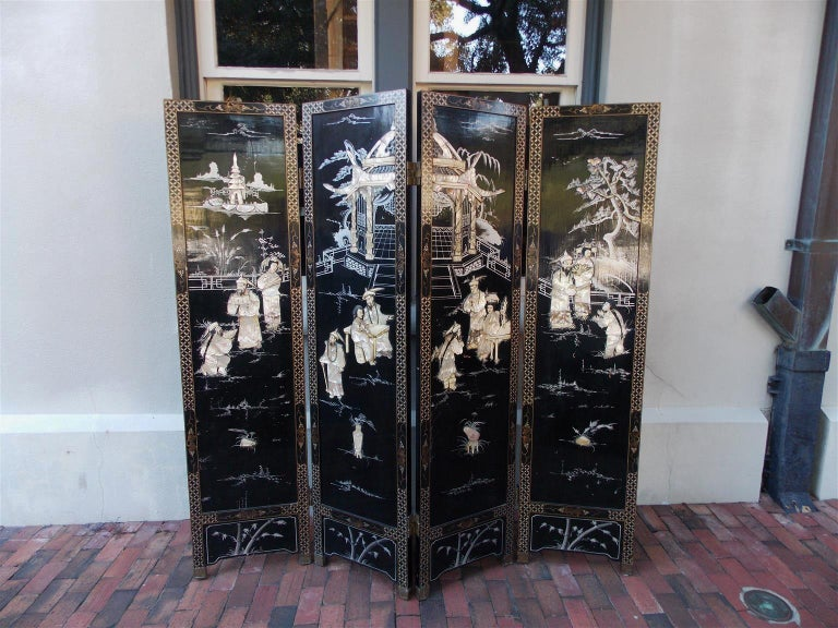 Chinese Coromandel figural black lacquer, soap stone, mother-of-pearl, and bone four-panel screen depicting pagoda and landscape scenes, decorative painted and gilt upper border panels, painted and gilt floral lower border panels, and reverse side
