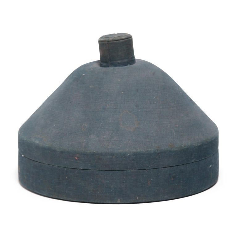 No self-respecting man in Qing-dynasty China would leave the house without some kind of hat. In fact, headgear was so central to social status that even the containers used to store one's hat were beautifully constructed.  This pointed hat box