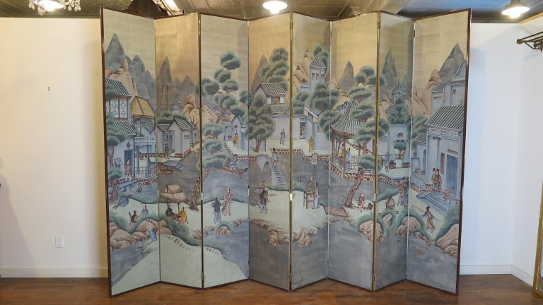 Midcentury Chinese painting folding screen. Chinese screen hand-painted over silver leaf. Elaborate hand-painted village scene depicting daily life within a rural mountain village. A day in the life of the village. Beautifully captured with great