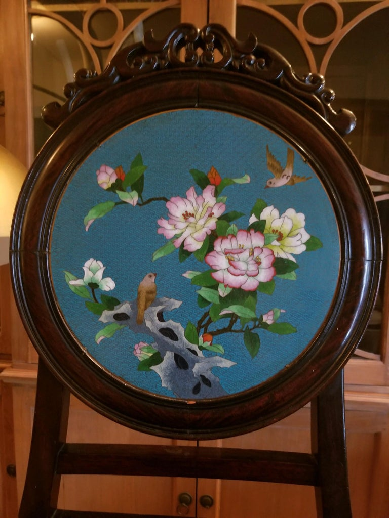 Chinese enameled back hall chair. Age unknown, but a spectacular piece. The enameling has metal framing and a wonderful floral scene with a Classic blue back ground. Use anywhere, dressing room, Entry hall or as pull up chair for dining. I love when