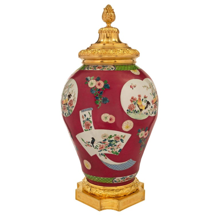 A beautiful 19th century Chinese Export porcelain urn with striking French 19th century Louis XVI St. ormolu mounts. The urn is raised by an elegant square ormolu base with concave corners and fine recessed chased panels and a striking wraparound