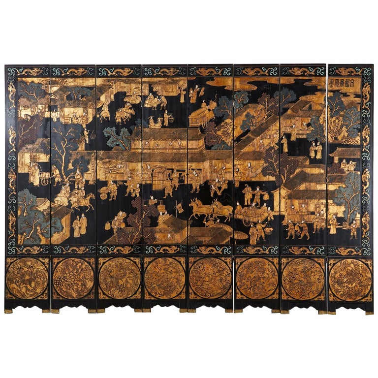 Fantastic Chinese export eight-panel Coromandel screen featuring a busy Chinese village. Black lacquer on wood core panels with Kuancai carved scenes filled with color pigments and gilt. The intricately carved screen depicts figures with animals in