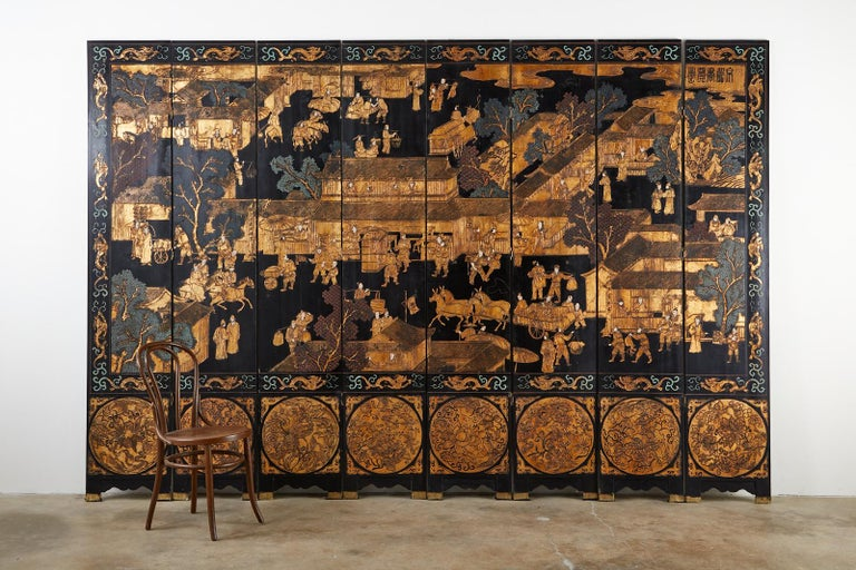 Chinese Export Eight-Panel Gilt Lacquered Coromandel Screen In Good Condition For Sale In Oakland, CA