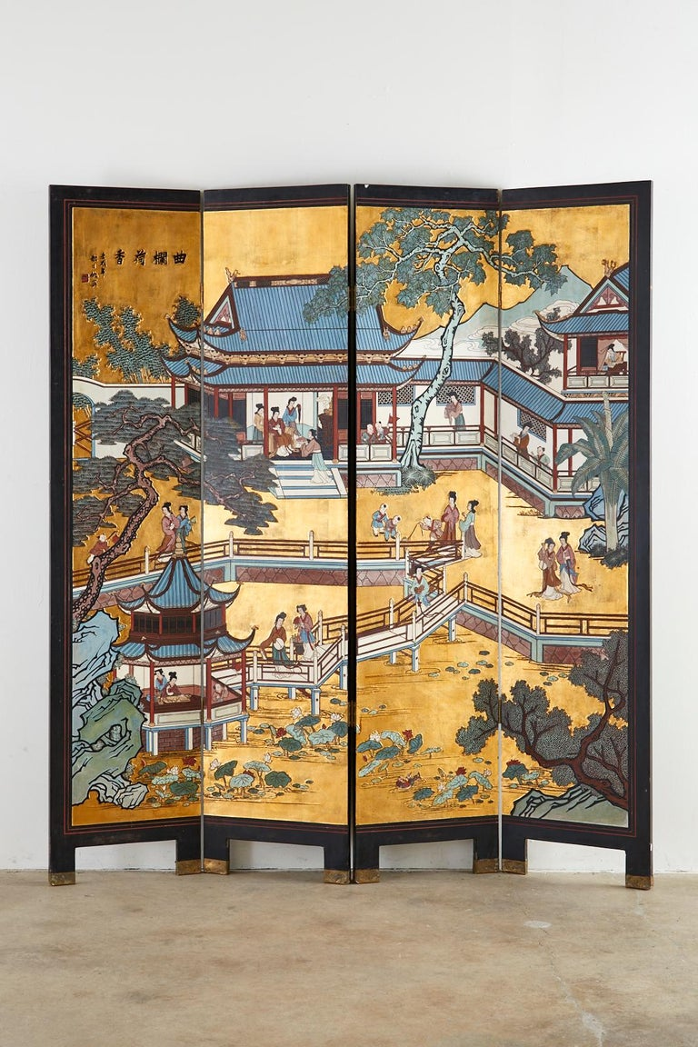 Fantastic Chinese export four-panel Coromandel screen featuring a stunning gold leaf background. The black lacquered hardwood panels are incised with vibrant color depicting an idyllic landscaped courtyard. Colorful pagodas and trees decorate the