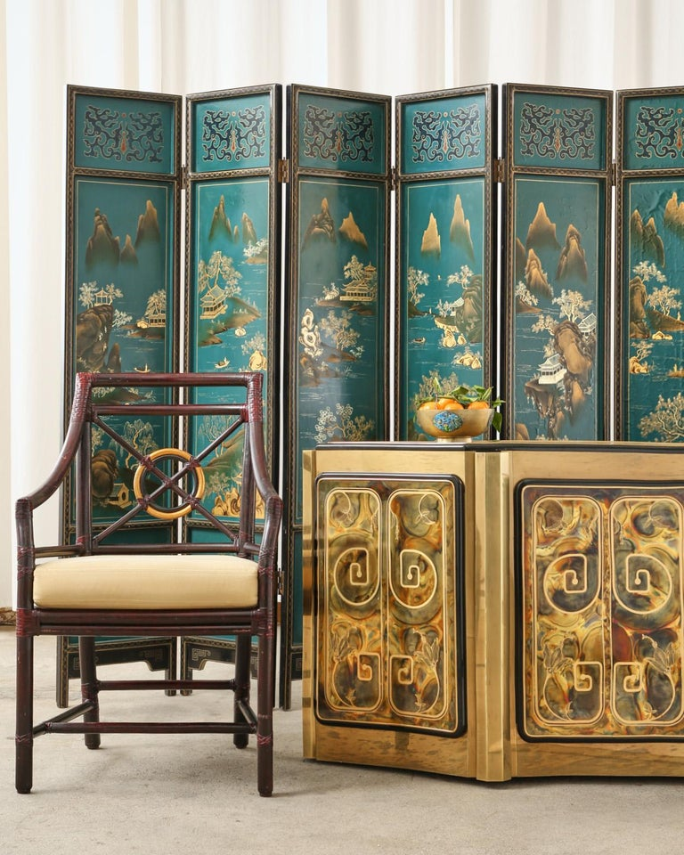 Charming Chinese export six-panel lacquered coromandel screen featuring idyllic painted mountain landscape scenes over a dramatic turquoise ground. The lacquered wood panels are inset with the painted scenes and have a geometric gilt border trim.