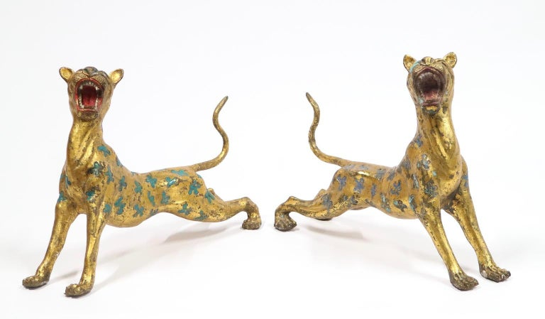 Pair of Chinese export leopard cheetah sculptures in gilt bronze with enameled spots in blue and turquoise. The pair was made in China during early 20th century. In great vintage condition with age-appropriate wear.