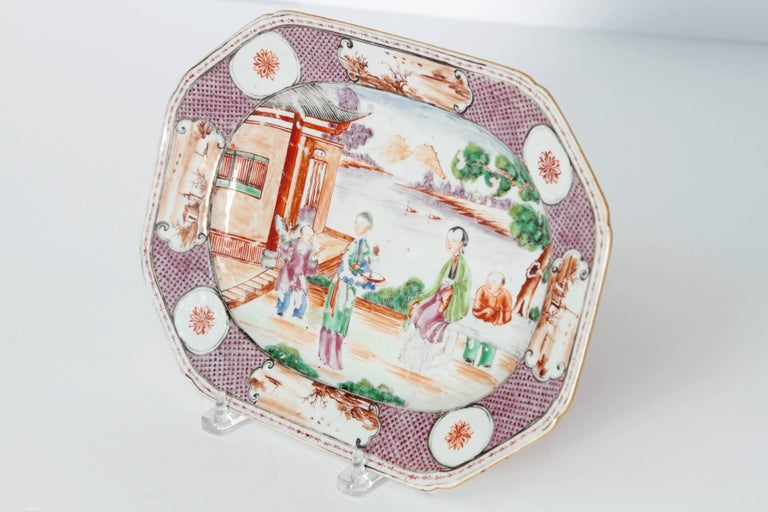 Chinese Manderin palette medium size platter. Center with famille rose women and children in courtyard. Border with small vignettes.