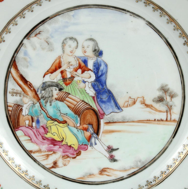 Chinese Export porcelain plate, the center painted with a troubadour playing a lute and reclining near a decanter and two glasses amidst two barrels, while a gentleman caresses a woman playing the triangle; the elaborate border painted with brightly