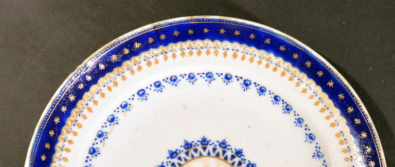 Chinese export Porcelain blue enamel plate made for the American Market,  circa 1785.  The small Chinese Export American-market plate has a central roundel in brown depicting an, as yet group of unidentified large Federal-style buildings, in a